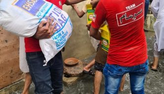 Rations being distributed in the floods